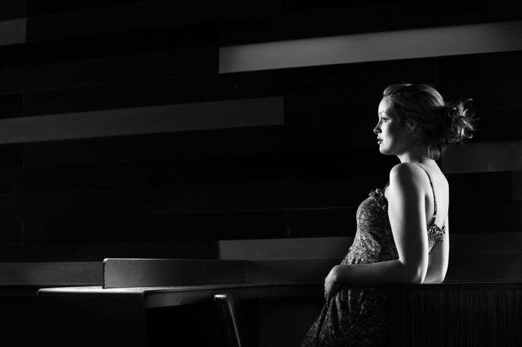 A girl reclines bathed in beautiful light in the Pitcher & Piano bar in Bristol