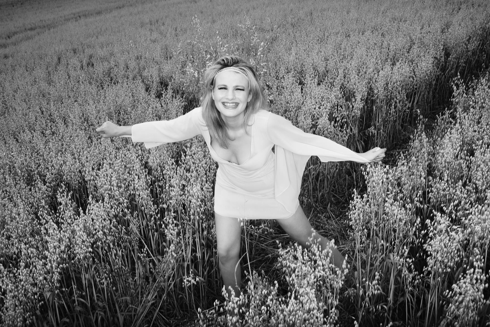 Chloe-Jasmine Whichello in a field of Barley in Somerset. Monochrome