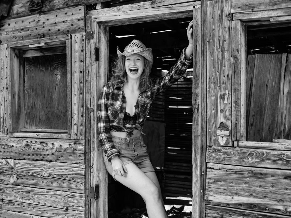 Claire Rammelkamp in a shack in the Wild West USA