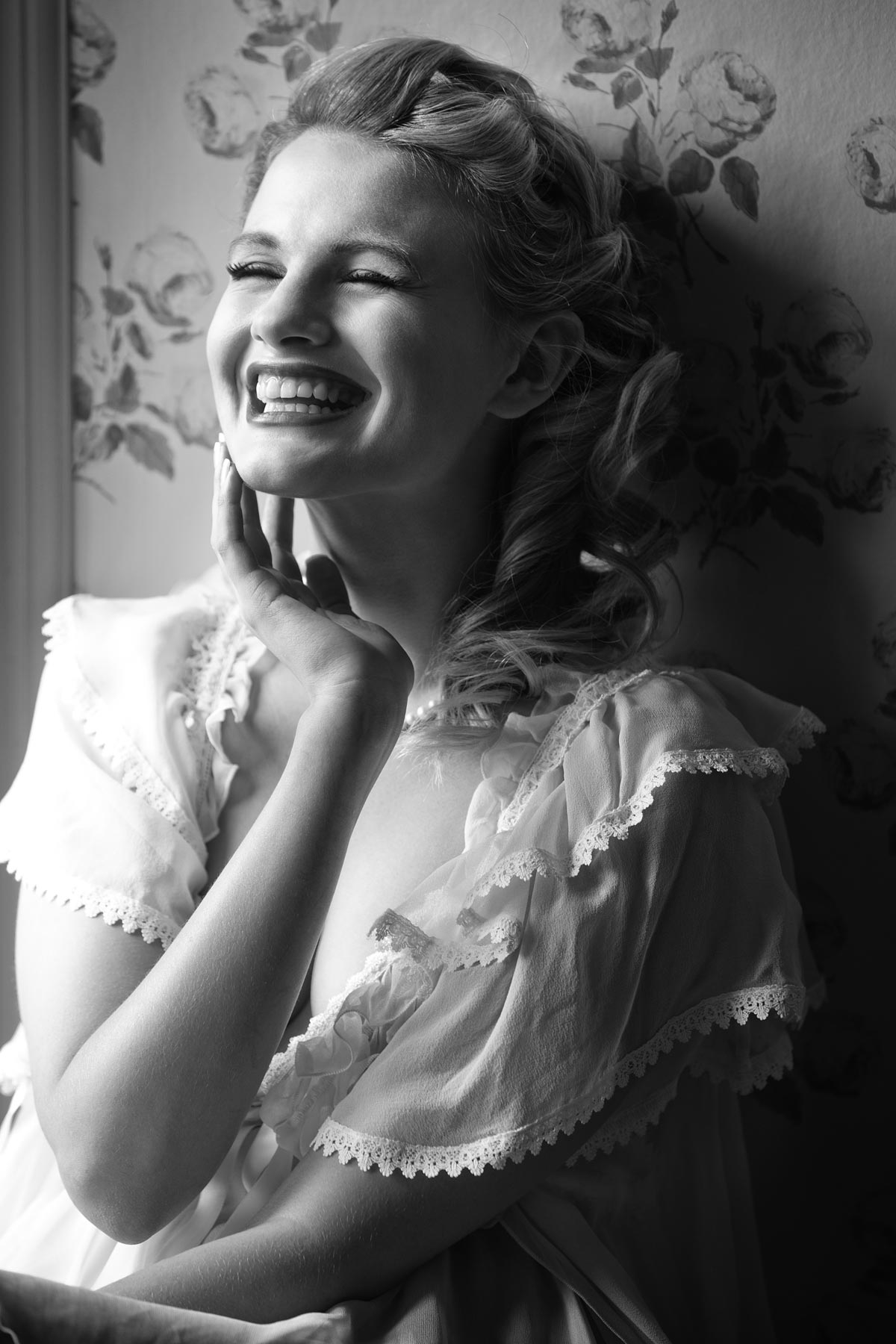 Chloe-Jasmine Whichello laughing in an English Rose setting. Mono print