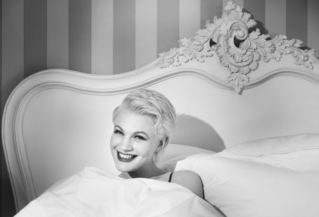 Chloe-Jasmine in bed in the gate cottage at Pipewell Hall, UK