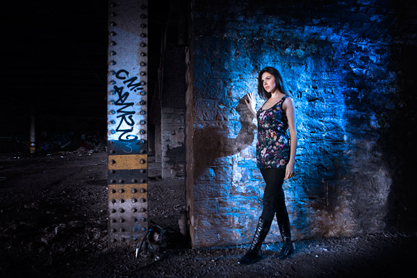 For this shot, I mixed ambient key light with a blue geled backlight