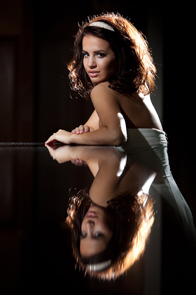 Two Speedlights on stands provided the light and a black bar top provided the reflection opportunity.