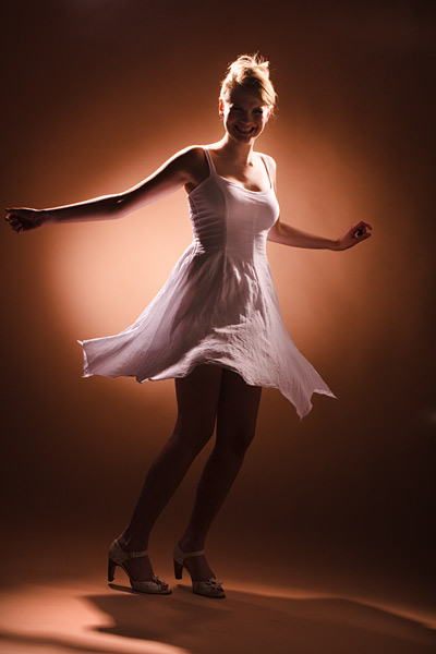 Minimalist lighting and a twirl. This is what you get when you switch off all the down stage lights in a Lovegrove rig.