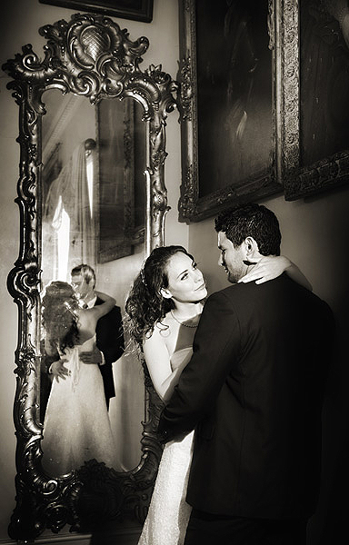 """2. Whilst you have the couple together, get them to show a moment of tenderness. I like to surprise clients at viewings with images that they didn't """"see"""" I placed the Arri to the right of the couple and shone it into the mirror, with the couples heads aligned off centre it allowed me to illuminate both their faces with the lamp and its reflection"""