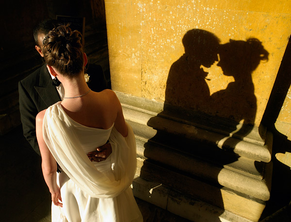 I created this shot up using the setting sun as my light source. I love not being able to see the faces of my couple because this forces the viewer to study their shadow instead. The double ogee moulding on the plinth tells the story enough to know that we are somewhere special; Blenheim Palace as it happens. I held the camera over my head to take the shot. This gave the higher than usual viewpoint to add interest to the composition. There's nothing difficult about taking any of the shots in this post. They just need thinking through and setting up.