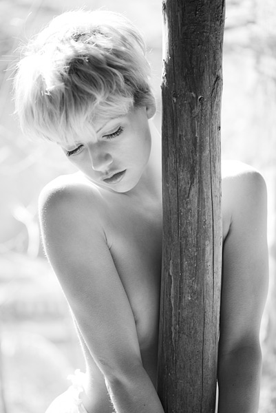 DL 4. I love the way the sunlight forms alters the contours of Katy's shoulders. A simple shot with softness and strength. The timber post is supporting the