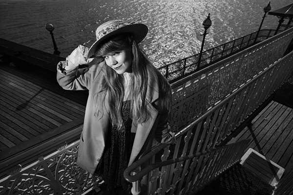 10. The pier has many cast iron railings and features. I used one Speedlight to light Sarah.