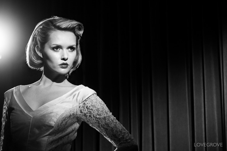 Just a pair of curtains as a background and a pair of Lupolux LED 650s give Carla Monaco that classic film star look. Note the vintage neck line to her dress and the curls in her hair. Carla's cheekbone is emphasised with a strong shadow created by using a 'down the nose' key light.