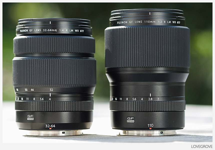 A side by side comparison of a Fujifilm GF 32-64mm lens and a GF 110mm f/2 lens