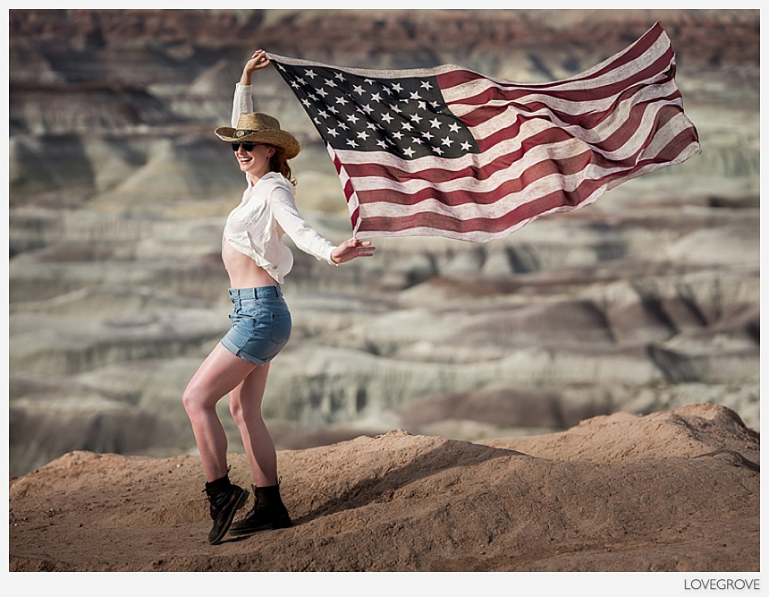 Claire Rammelkamp holding the USA flag on the 2017 wild west adventure